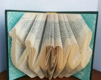 travel - Folded Book Art - Fully Customizable, symbol forever