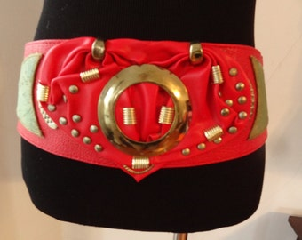 Awesome 80s wide belt with bow sits at waist sz Small/ Medium red & gold studded gaudy great for costumes