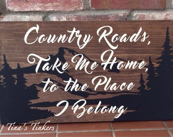 Country roads take me home to the place I belong. Painted wood sign.
