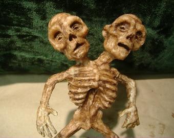 Two headed Alien fetus sideshow gaff freak