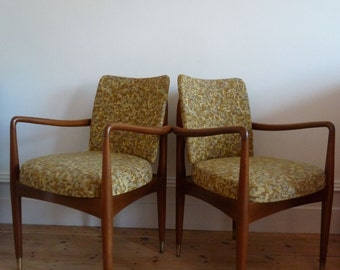 A Pair of Mid Century Chairs with Brass Feet and Original Upholstery