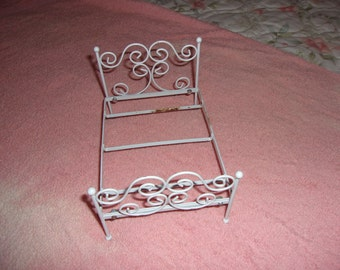 Vintage white metal doll bed