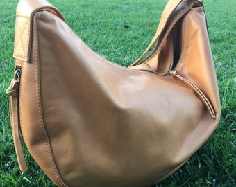 Slouchy real leather handbag, hobo soft leather shoulder bag. Cross body with wide strap, cotton lined. Extra side pockets.