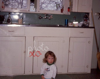 Kristy in the kitchen, 1968