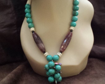 One strand turquoise necklace with cluster drop
