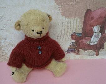 Teddy bear handmade in a sweater
