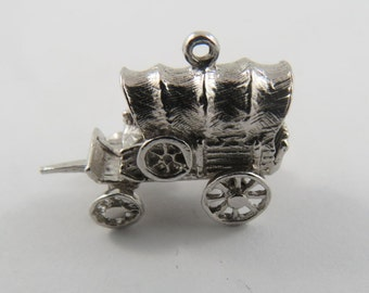 A Sterling Silver Charm of an Old Fashioned Stagecoach.