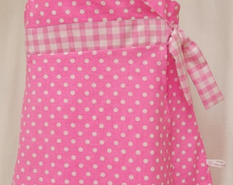 Bright pink polka dot crossover dress with gingham detail and tie, age 5