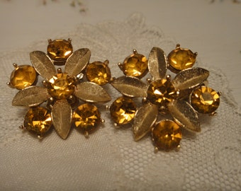 Vintage Sarah Coventry Amber Lites clip earrings with goldtone leaves and Austrian amber rhinestones