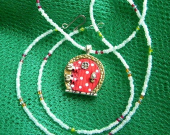 Fairy door, hobbit door pendant coral red with white polka dots on beaded necklace, wishing fairy door beaded necklace