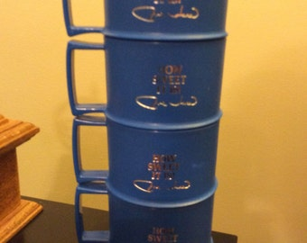4 Tupperware stacking Mugs Stackable. 1312-27. How Sweet it is. Signed. Like new. Navy Blue