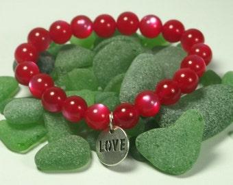 Bracelet with red beads said. LOVE bracelet. Cat eye beads bracelet. Elastic beaded bracelet.