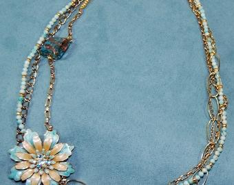 Large teal flower necklace
