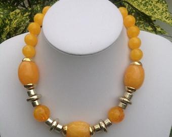 Gorgeous vintage gold tone metal and orange bead necklace