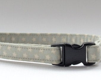 Cat collar made in Tilda star fabric, grey/green. with silver bell and breakaway clasp