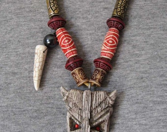 Krampus tiki tribal style necklace bone colored talisman Christmas devil