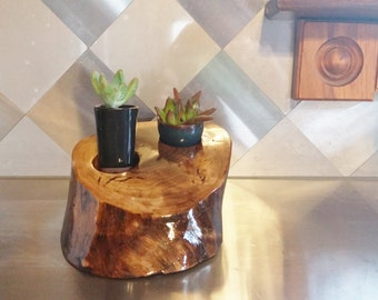 Walnut planter stand with two minature ceramic pots.