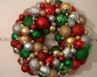 Traditional Christmas wreath, red, green, gold and silver