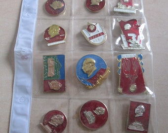 A set of 12 Vintage Chinese Metal Badges