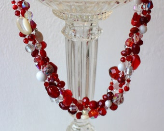 Red collar 4 rows made of stones and glass beads.