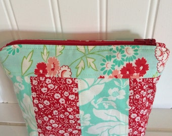 Aqua and red zippered pouch