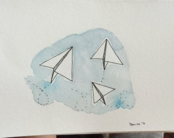 Painting in watercolor paper airplanes