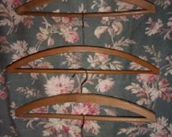 4 antique wood hangers