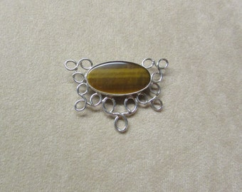 Gorgeous Tiger's Eye STERLING silver Pin/Pendant with a lacey wire design .