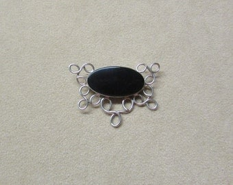 Striking Black Onyx STERLING silver PIN with a lace-like wire design.