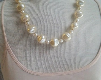 Vintage costume pearl necklace with an irresistible glossy shine