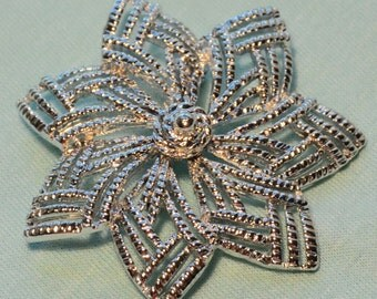 Shiny Silver Star Brooch by Sarah Coventry