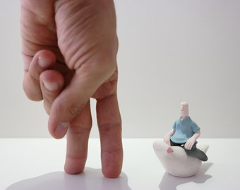 Handmade Ceramic Sculpture Figurine Unique / a man sitting on the bird