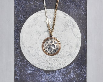Crater Moon Necklace - hand hammered sterling silver dome and oxidized brass pendant - on long mixed metals vintage chain