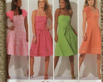 Simplicity Pattern 4224-Dresses with skirt variations snd shrugs-Size H5 (6, 8, 10, 12, 14)-New and uncut
