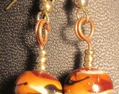 Tiger stripe lampwork glass artisan earrings Amber Brown Black Copper Brass