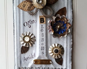 Mixed media Tin assemblage metal wall hanging sign folk art flower upcycled vintage beauty often blossoms amidst adversity