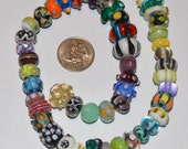 Destash - Huge string of 50 Assorted Lampwork Glass Beads in Various Shapes