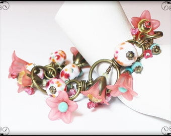 Bell Flower... Handmade Jewelry Bracelet Beaded Lampwork Glass Crystal Lucite Flower Cha Cha Pink Teal Turquoise Aqua Yellow Antique Brass