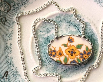 Recycled china jewelry. Broken china jewelry oval necklace Art Deco floral yellow green and blue made from a broken plate
