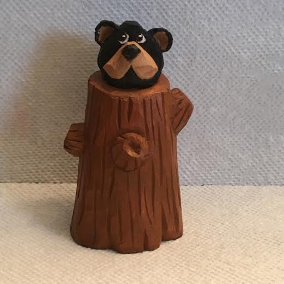 Hand carved bear cub in tree stump wood carving cabin decor
