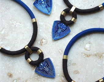 StayGoldMaryRose - Vintage blue willow china spearhead rope neck piece.