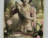 French April 1st Postcard - Woman Holding a Fish (Poisson D'Avril)