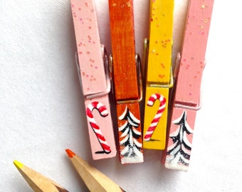 PAINTED CHRISTMAS CLOTHESPINS  pink orange yellow glitter snow covered trees candy canes magnets