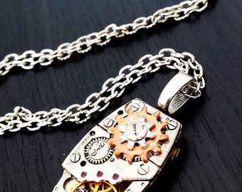 Oblong Steampunk Inspired Pendant with Cogs, Gears and Ruby jewels