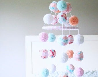 POM POM MOBILE. coral + mint + peach + white + light pink + confetti pom pom mobile. darling mint + coral + pink baby mobile