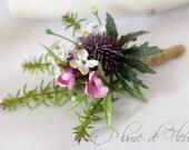Petrie - Men's Buttonhole / Boutonniere - Rustic, country garden style buttonhole, mauve thistle, lilac, mini daisies and foliage.