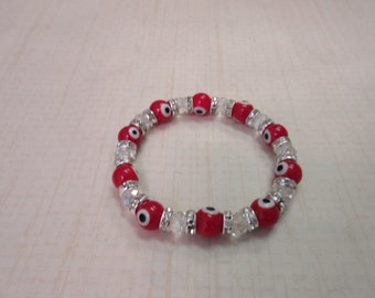 Red and Clear evil eye beaded bracelet