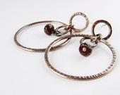 Copper hoop earrings with garnets. Textured circle bohemian earrings.
