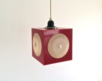 Dark red ABS plastic cube pendant lamp or hanging lamp with round lenses. Space age Scandinavian design.