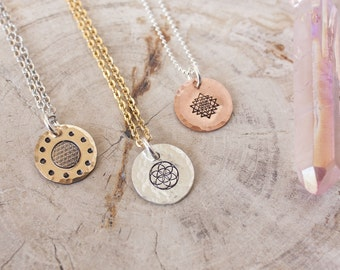 Sacred geometry necklace in your choice of metal. Flower of life, Seed of life, or Sri Yantra necklace. Hand stamped charm necklace.